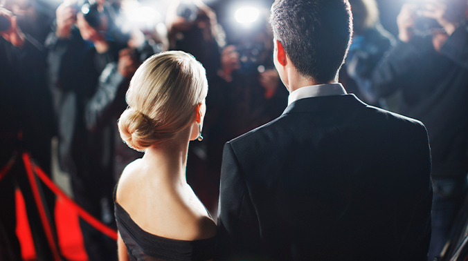 Man and woman on the red carpet at the Oscars 2019